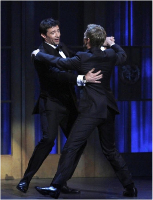 Real men dance ... with each other ... while singing musicals! Bro's before ho's. Word.