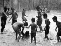 Playing in the rain in Bangladesh