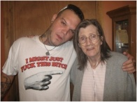 """Cameraman: """"Hey Stu, how about you take your shirt off to have one of the last pictures with your mom, the emphysema patient, before she dies"""" Stu: """"No way bro' I love this fuckin' shirt. I wanna remember me an my mom havin' a laugh. Take the fuckin' picture"""""""