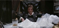 Tony Montana, thinking this pile of cocaine is as good as a tray of chocolate muffins. Well, Tony,